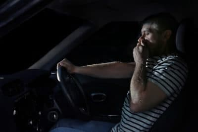 Man driving at night while experiencing dizziness from Rohypnol