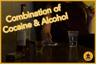 woman with alcohol and cigarettes making lines of cocaine alcohol and cigarettes