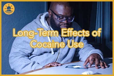 Man looking at cocaine